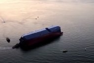 Capsized Car Carrier Being Debunkered