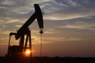 Crude Losses Offset by Hope of Rosy OPEC Outcome